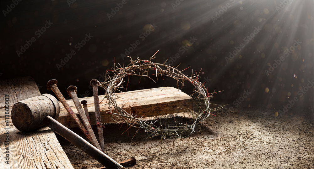 Fototapeta Passion Of Jesus  - Wooden Cross With Crown Of Thorns Hammer And Bloody Spikes