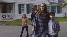 Family Walks Away From A Colonial Style Building And Past A Do Not Enter Sign