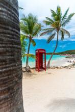 British Phone Box In Front Of Caribbean Sea, Dickenson Bay, Antigua