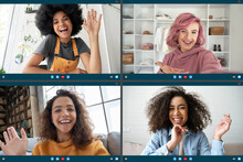 Four Happy Multicultural Diverse Friends Young Women Talking During Online Virtual Chat Video Call In Group Conference Social Distance Chat Virtual Meeting. Computer Videocall App Montage Screen View.