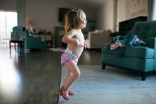 Cheerful Shirtless Girl Dancing At Home
