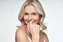 Happy Smiling Attractive 50s Middle Aged Blonde Woman Looking At Camera Advertising Antiage Face Skin And Aging Hair Care Treatment And Cosmetics Isolated On White Background. Close Up Portrait.