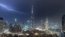 Dubai Skyline And Burj Khalifa Under Stormy Night Sky With Lightning
