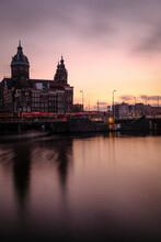 Basilica Of Saint Nicholas By Oudezijds Voorburgwal Against Sky During Sunset