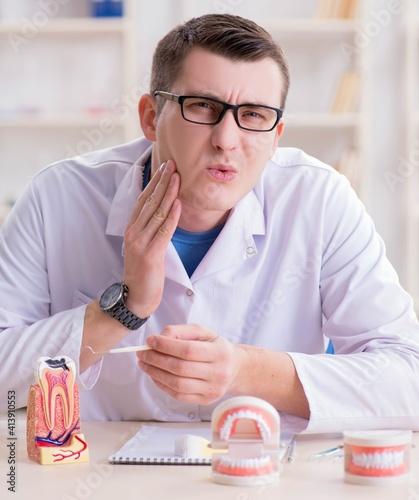 Fototapeta Dentist working teeth implant in medical lab obraz