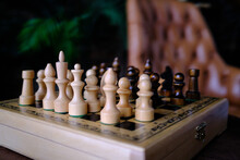Black And White Chess On A Wooden Chessboard In A Classic Study