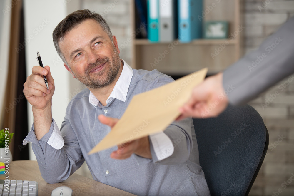 Fototapeta businessman working with papers and computer working at office