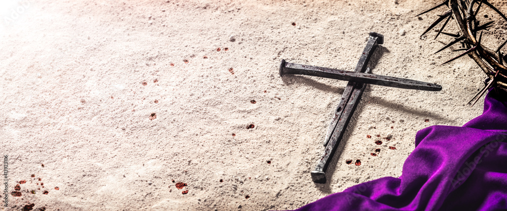Fototapeta Three Nails In Shape Of Cross With Purple Robe, Crown Of Thorns And Blood Drops On Dirt Floor - Crucifixion Of Jesus Christ