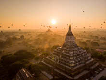 Aerial View Of Shwesandaw Buddhist Pagoda, Historical Site With Hot Air Balloons In Background At Sunset, Nyaung-U, Myanmar.