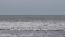 Rough Ocean Waves In Winter With Grey Overcast Conditions.  Static Medium Shot