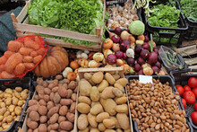 Potatoes And Other Vegetables On Market