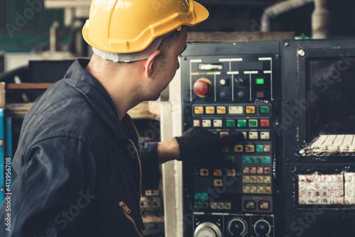 Obraz na plátně Skillful factory engineer or worker do machine job in manufacturing workshop