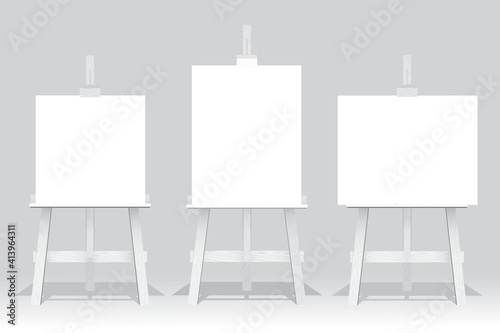Canvas Print Wooden easel stand with blank canvas on white background
