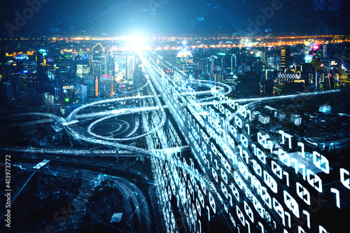 Fototapeta Futuristic road transportation technology with digital data transfer graphic showing concept of traffic big data analytic and internet of things . obraz