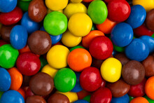 Background Of Rainbow Colored Candy Coated Chocolate Buttons