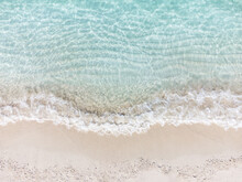 Aerial Top View Of Beautiful Tropical White Sand Beach With Wave Foam And Transparent Sea, Summer Vacation And Travel Background With Copy Space, Top View From Drone