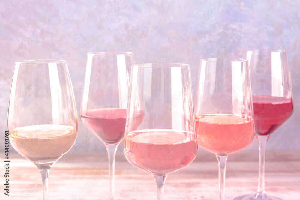 Fototapeta Various styles of rose wine, side view with a place for text, toned image