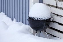 A Barbecue That Has Been Covered In Snow