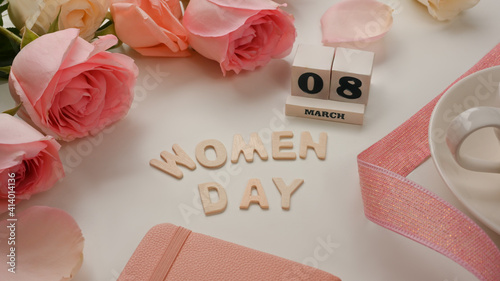 Obraz 8 March Happy Women's day on white background decorated with pink flowers and ribbon - fototapety do salonu