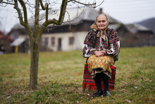 Old Romanian Woman Outdoor In The Garden