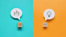 Cubes: One Is Sad With A Question In His Head And The Second Is Cheerful With A Solution In His Head. The Symbol Is Not Knowledge In The Head Of One Person And Creative Ideas In Another