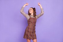 Photo Of Optimistic Girl Look Empty Space Arms Up Wear Spectacles Brown Shirt Dress Isolated On Lilac Color Background