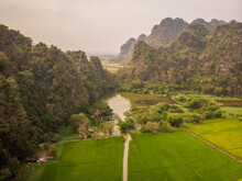 Aerial View Of Mahar Sedan Caves With A Small Lake In Foreground During A Foggy Day, Hpa-an Township, Myanmar.