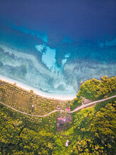 Aerial View Of Lamin Guntur Luxury Resort With A Few Bungalow Facing The Blue Water Of Celebes Sea, A Tropical Destination Island, Kalimantan Timur, Indonesia.