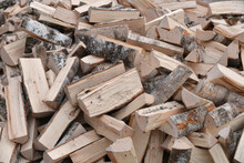 A Stack Of Birch Firewood Close Up. Lot