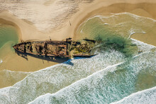 Aerial View Of A Few Tourists Looking At S.S. Maheno, A Ship Wreck Beached On Fraser Island Coasts, Queensland, Australia.