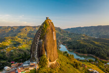 Aerial View Of Piedra Del Penol Touristic Attraction, A Huge Rock With Steps To The Top Near Guatapé Town, Antioquia, Colombia.