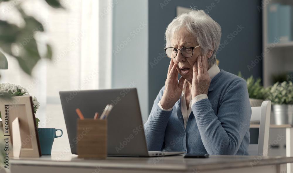 Fototapeta Senior woman struggling with technology