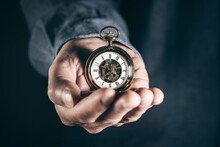 Man Holding Pocket Watch Concept For Time
