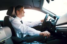 Businessman Driving A Luxury Car