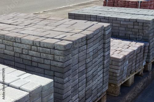 Obraz na plátně Concrete pavement tiles stacked on the pallets on outdoor warehouse