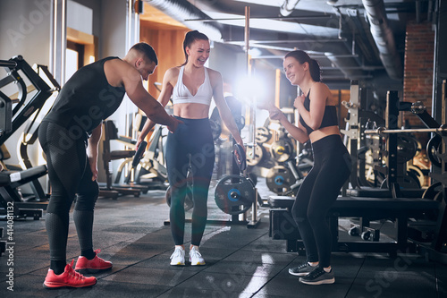 Obraz Cheerful friends having fun together during workout - fototapety do salonu