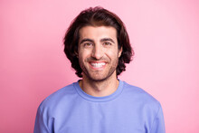 Photo Of Happy Positive Young Man Wear Purple Pullover Good Mood Smile Isolated On Pink Color Background