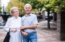 Mature Couple Of Man With A Woman Strolling Outdoor In Park