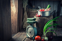 Wooden Cellar With Canned Food And Vegetables