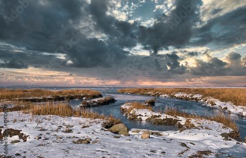 Fototapeta Ebb tide Road on the wadden sea to the island Mandoe, Esbjerg Denmark
