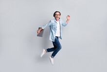 Full Length Body Size View Of Handsome Cheerful Amazed Man Jumping Carrying Laptop Running Isolated Over Grey Pastel Color Background