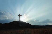 Christian Cross On Hill Outdoors At Sunrise. Resurrection Of Jesus