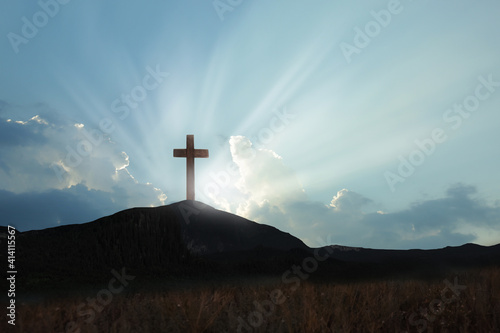 Fotografija Christian cross on hill outdoors at sunrise
