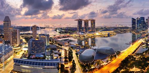 Fototapeta Skyscrapers of Singapore skyline at the beautiful sunset, aerial panorama obraz