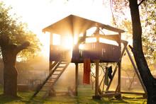 Sun Shining Through Kids Playground With Dust Particles. Best Kids Playground. How To Make Kids Playground