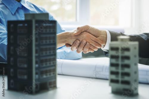 real estate development - businessmen handshake after successful agreement of co Fototapet