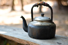 Old Teapot On A Wooden Table