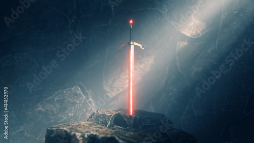 Fototapeta sword in the stone with light rays and dust specs in a dark cave obraz