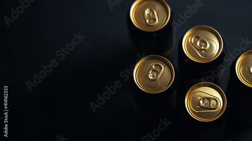 Closed beer cans on a dark stone table, copy space. Craft beer in an aluminum can © pavelkant
