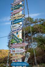 Caribbean, Grenada, Mayreau Island. Signs On Boat Mast.